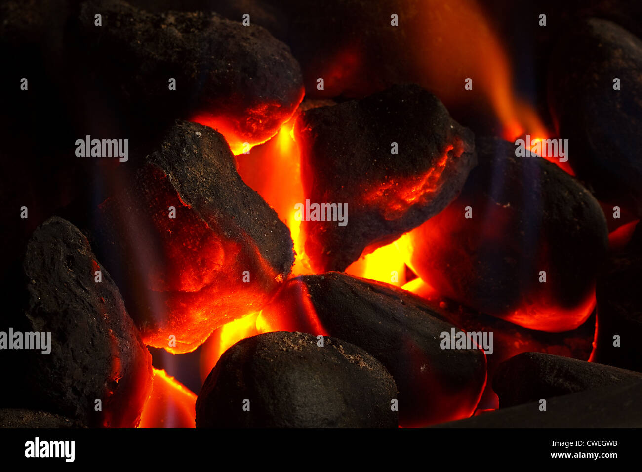 Imitation coal fire, powered by gas supply - Stock Image