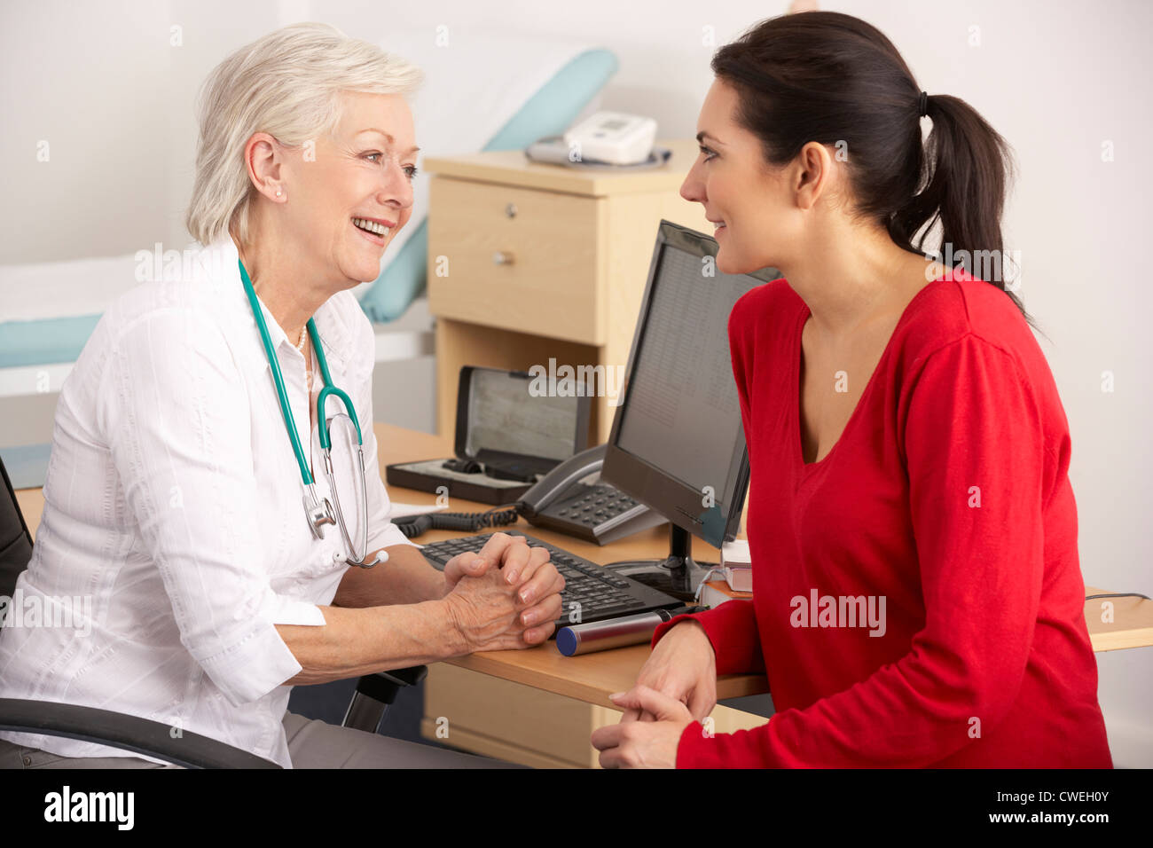 British GP talking to woman patient - Stock Image