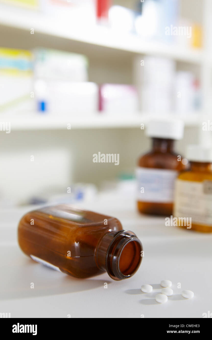 Prescription pill bottles on pharmacy shelf - Stock Image