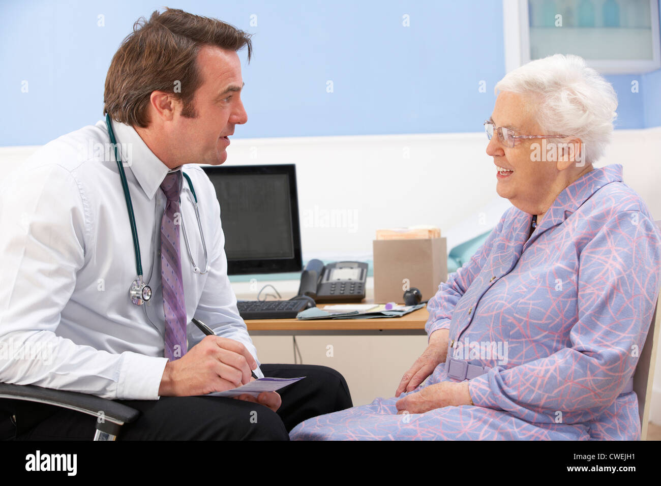 UK GP talking to senior woman patient Stock Photo