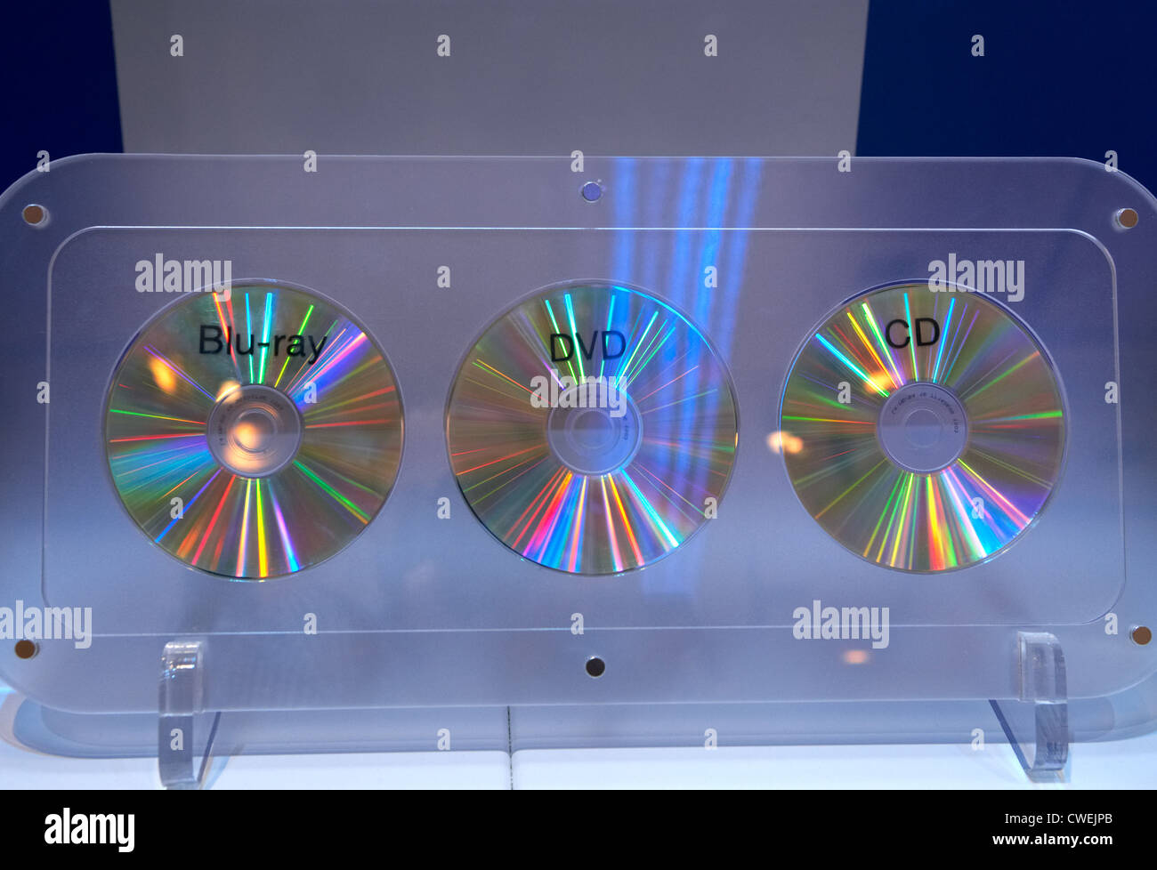 The media Blu-ray Disc, DVD and CD side by side - Stock Image