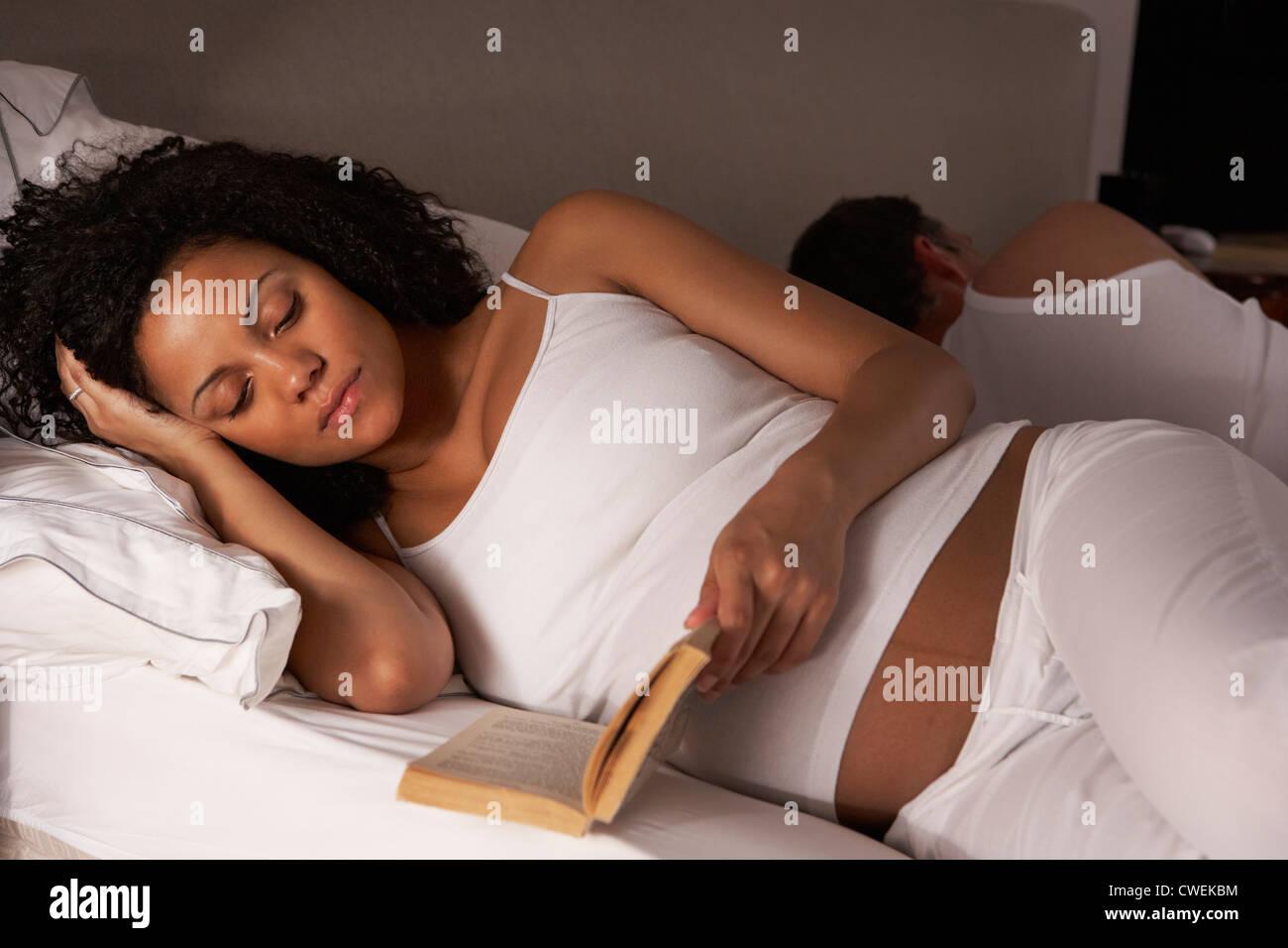 Pregnant woman unable to sleep - Stock Image