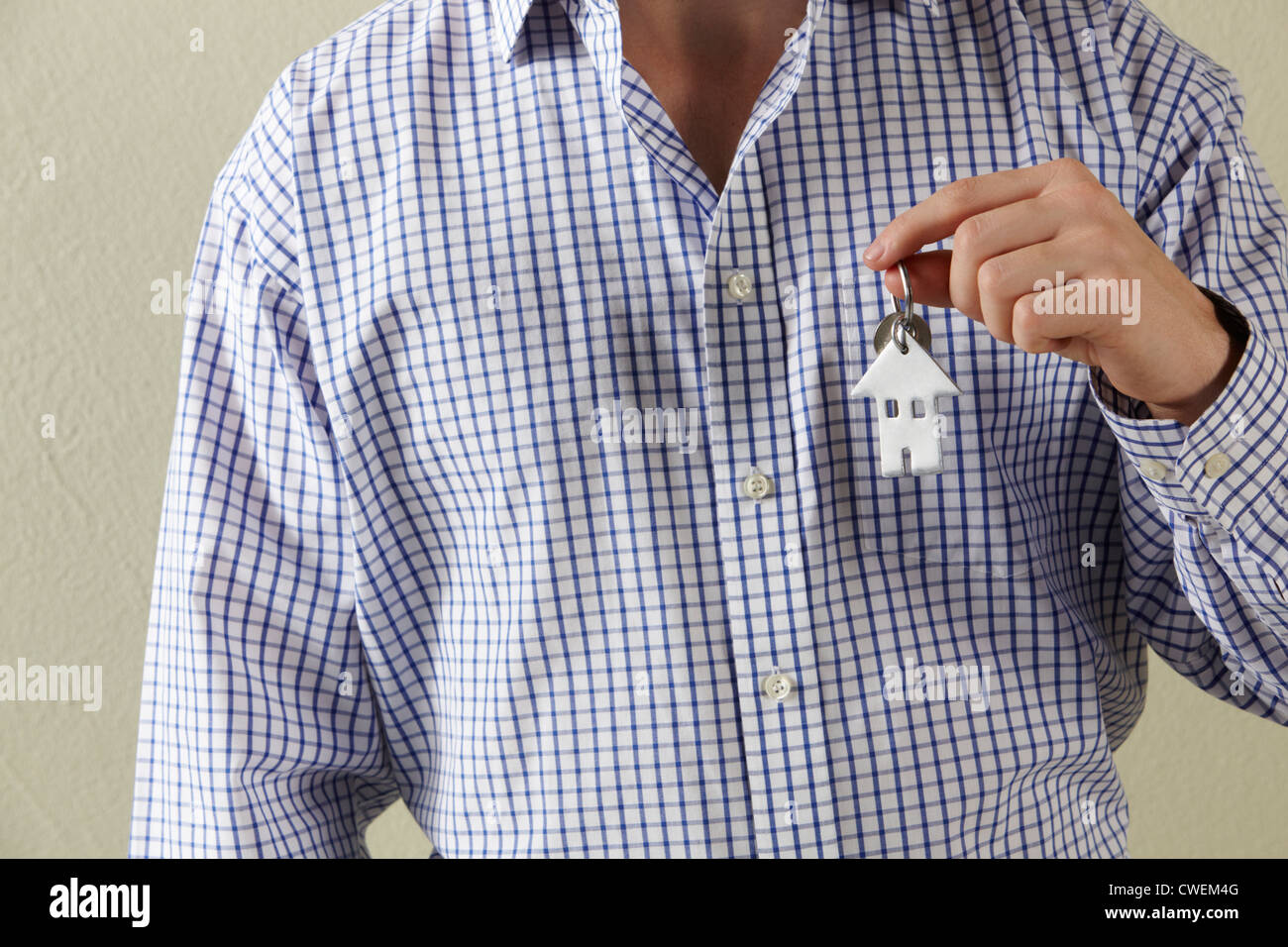 Cropped Shot Of Man Holding Keys To First Home - Stock Image