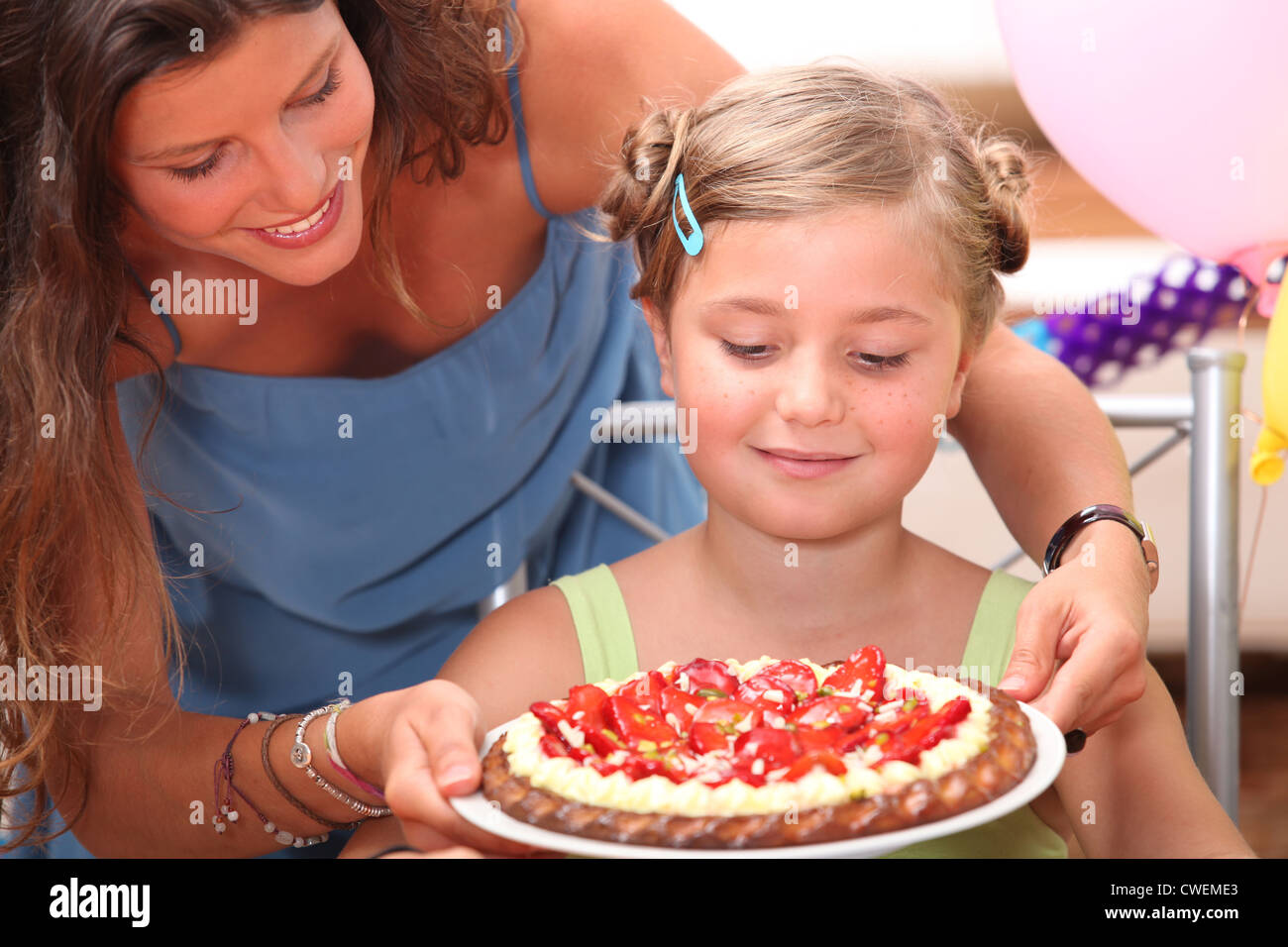 mother giving daughter cake stock photo 50110539 alamy