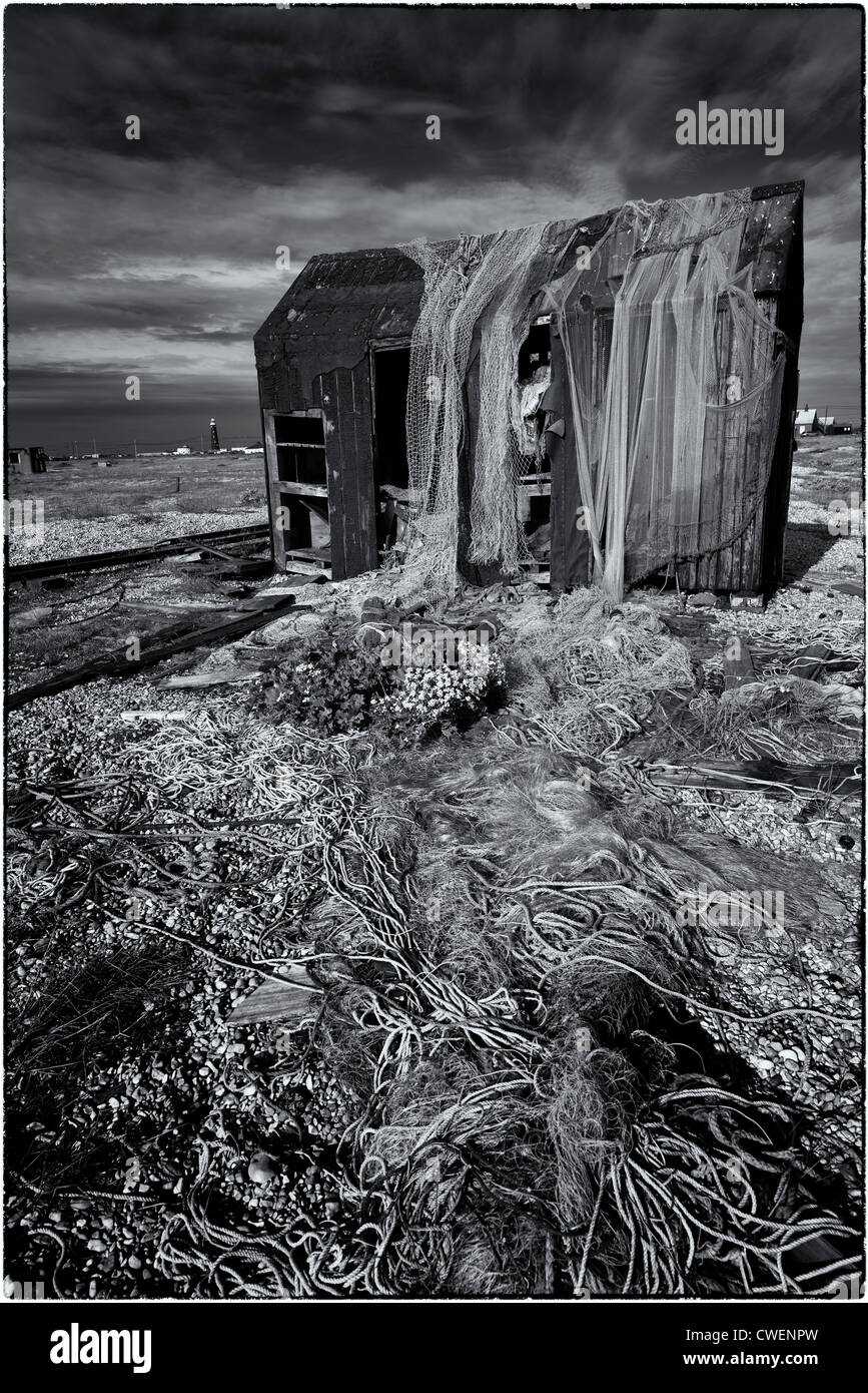 Derelict fishing hut on Dungeness, abandoned nets and equipment Stock Photo