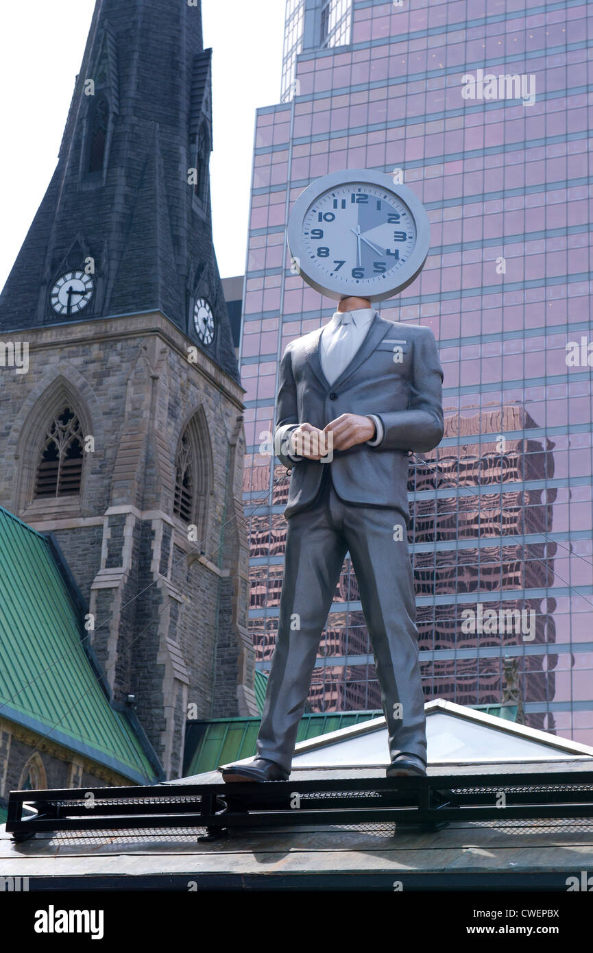 Mannequin with clock head at Les Promenades de la Cathédrale in downtown Montreal. - Stock Image