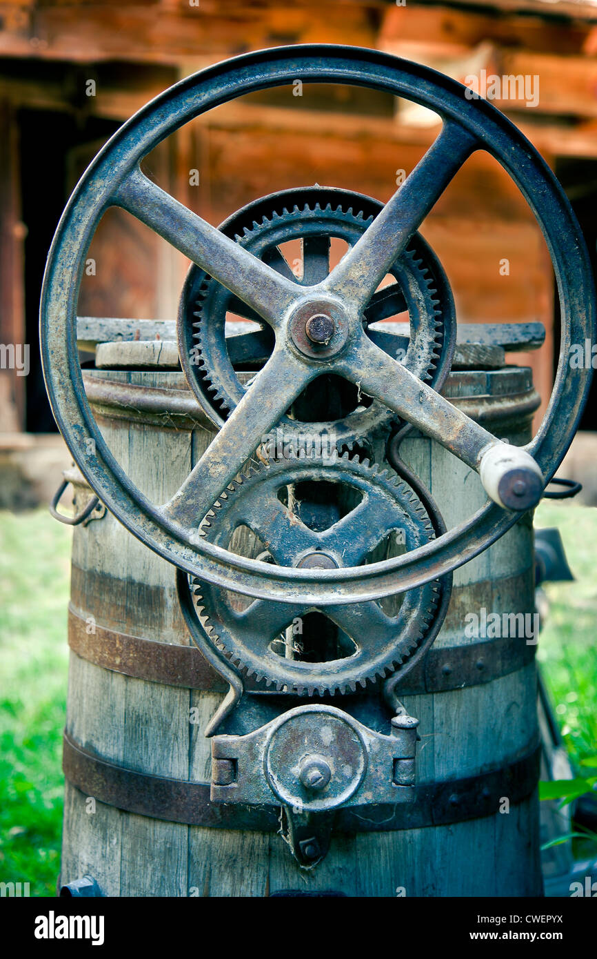 Old iron gears of centrifuge machinery - Stock Image