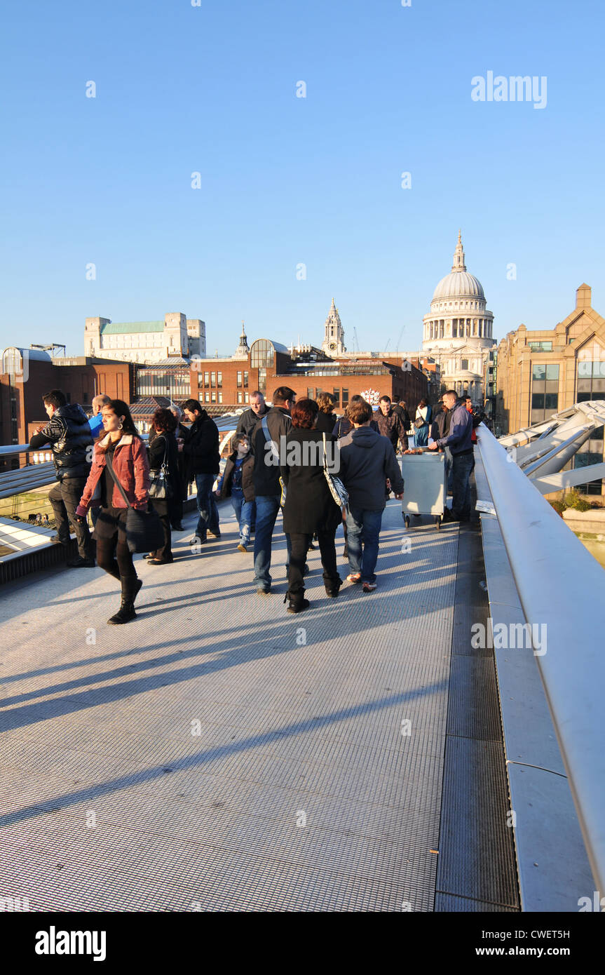 London, UK - 19 Nov, 2011: Tourists walking on the Millennium Bridge towards Saint Paul Cathedral - Stock Image