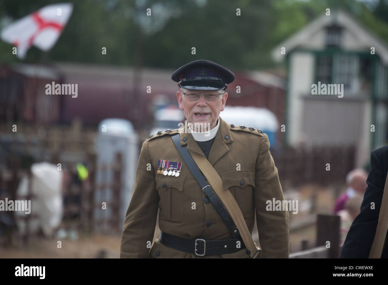 British Army Chaplain in Railway environment - Stock Image