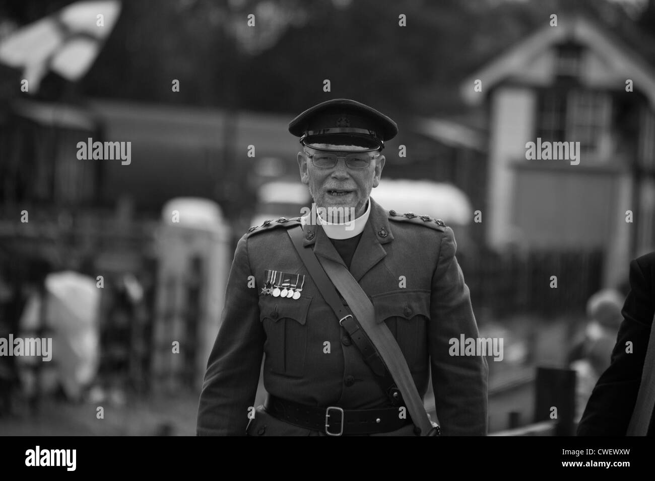 British Army Chaplain in Railway environment - Stock Image