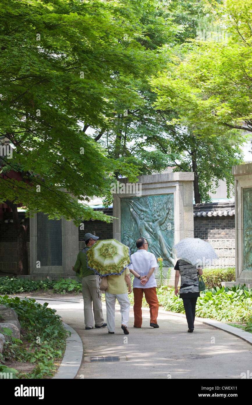 Elderly Korean people take a leisurely stroll through Topkol park in Seoul, Korea. - Stock Image