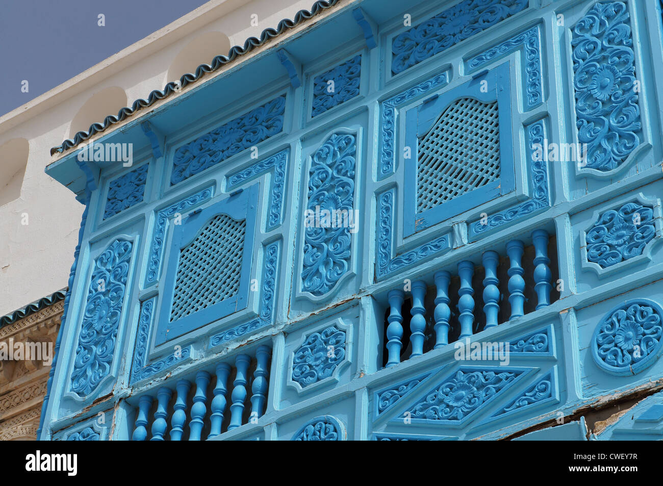 Blue bow window in the traditional tunisian architecture - Stock Image