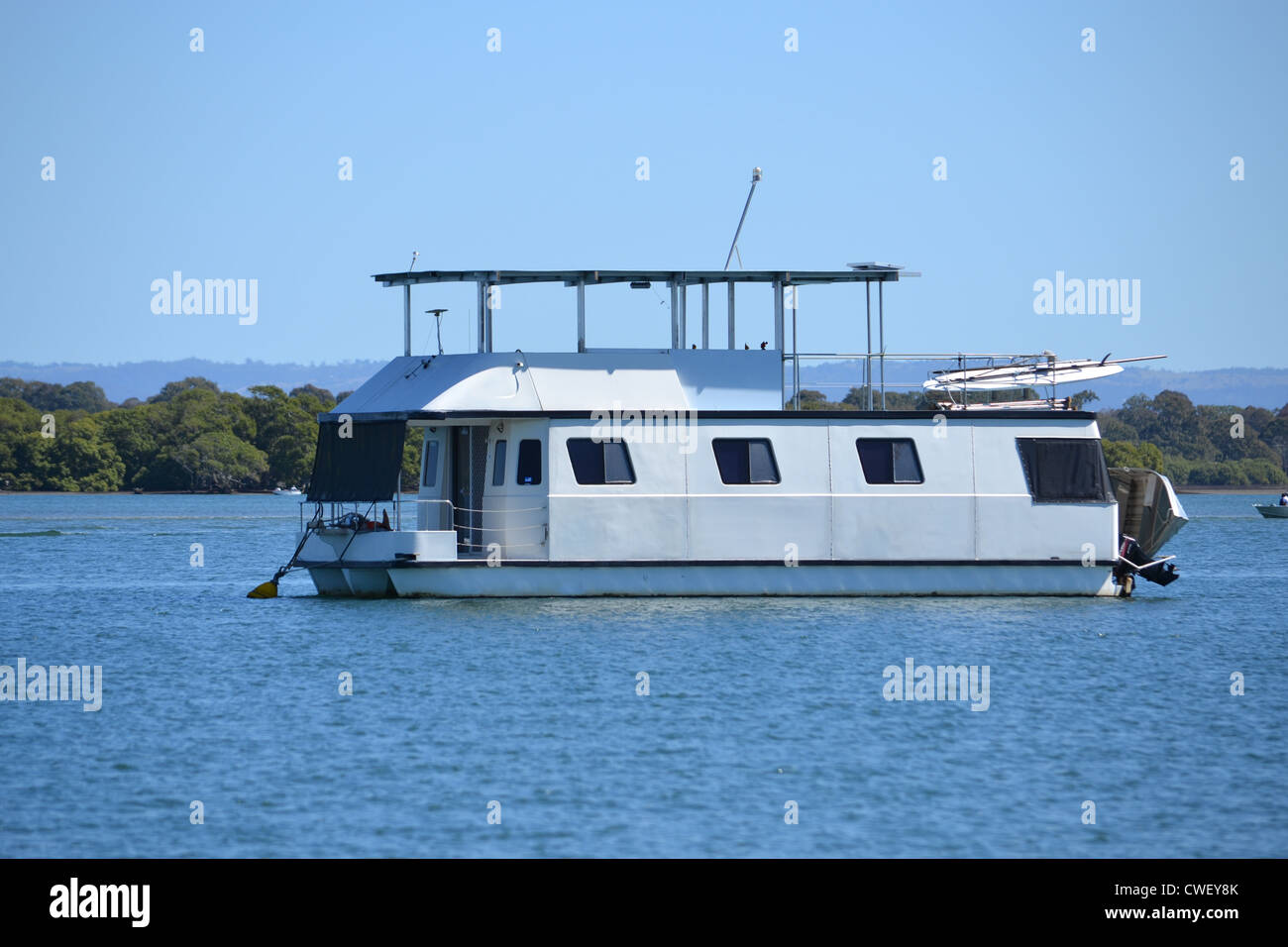 Houseboat anchored off Bribie Island, Queensland, Australia - Stock Image