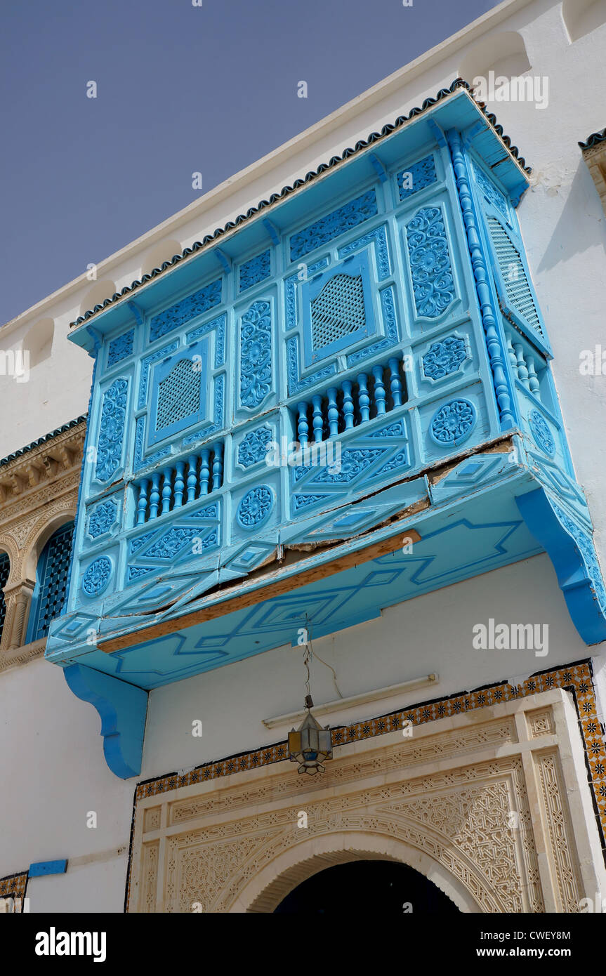 Traditional tunisian architecture with blue windows and white facades - Stock Image