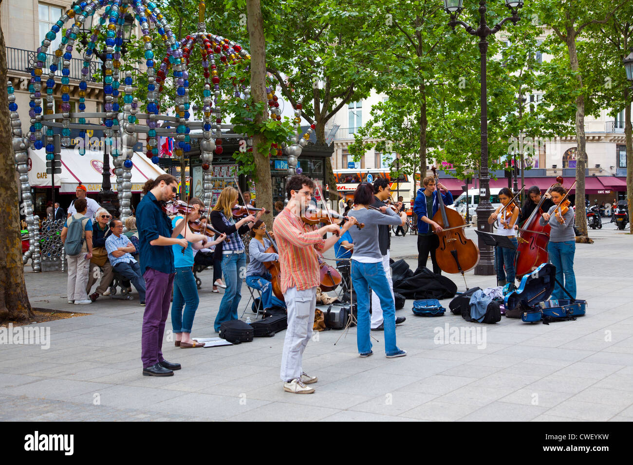Street buskers performing in Place du Palais Royal in Paris France - Stock Image