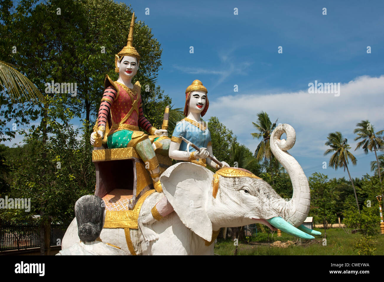 Statue of a white elephant with figures of the Buddhist mythology at the Kampong Ampil monastery, Battambang, Cambodia - Stock Image