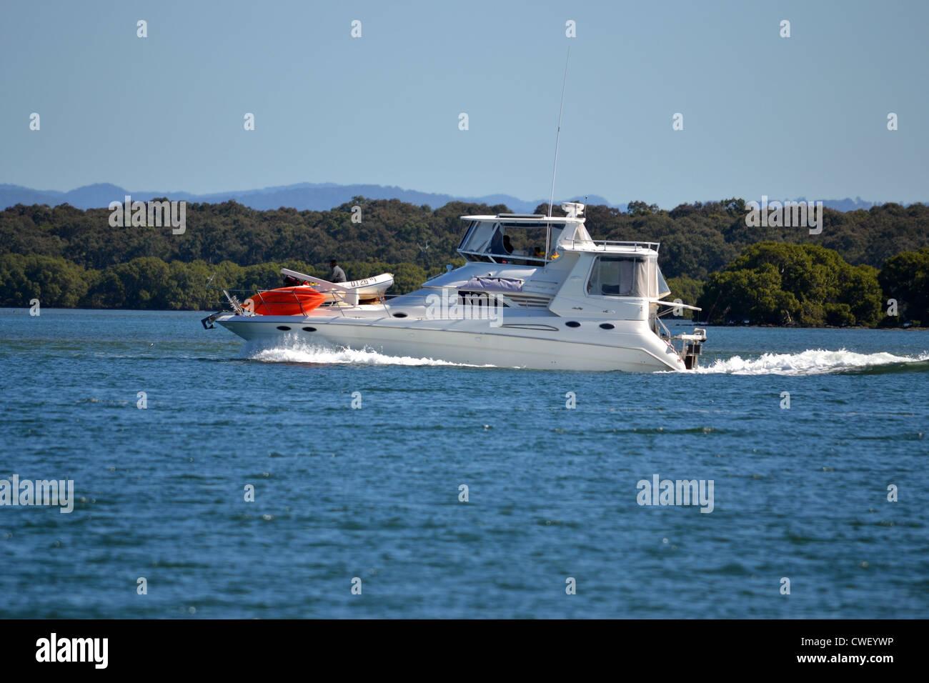 A yacht cruising along - Stock Image