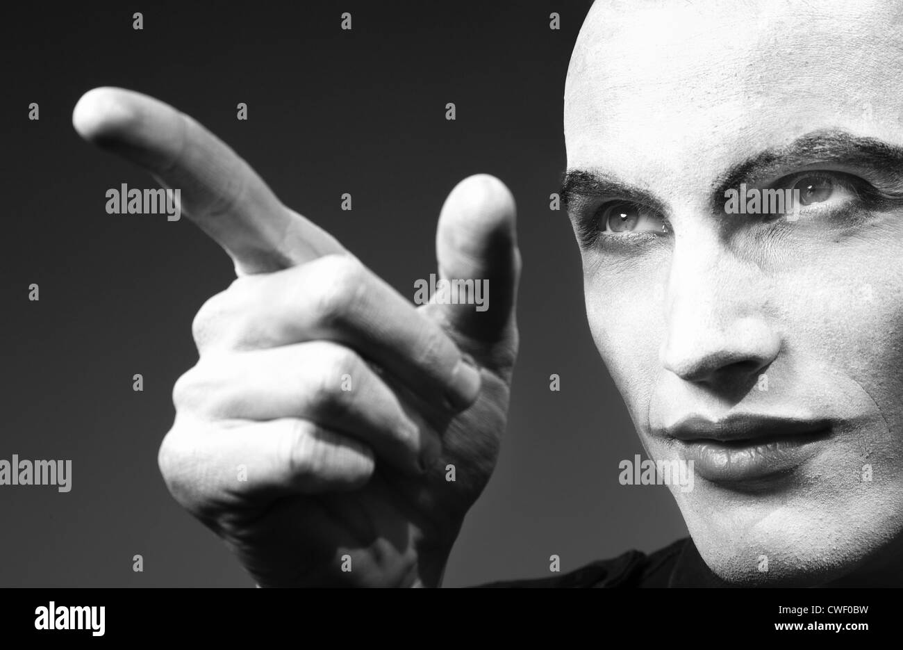 Mad angry funnyman pointing finger. Black and white photo. Artistic darkness added - Stock Image