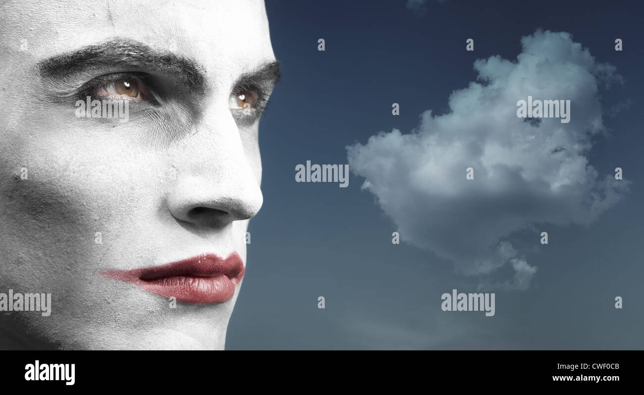 Headshot of the vampire outdoors and cloud on the background. Artistic colors and darkness added - Stock Image