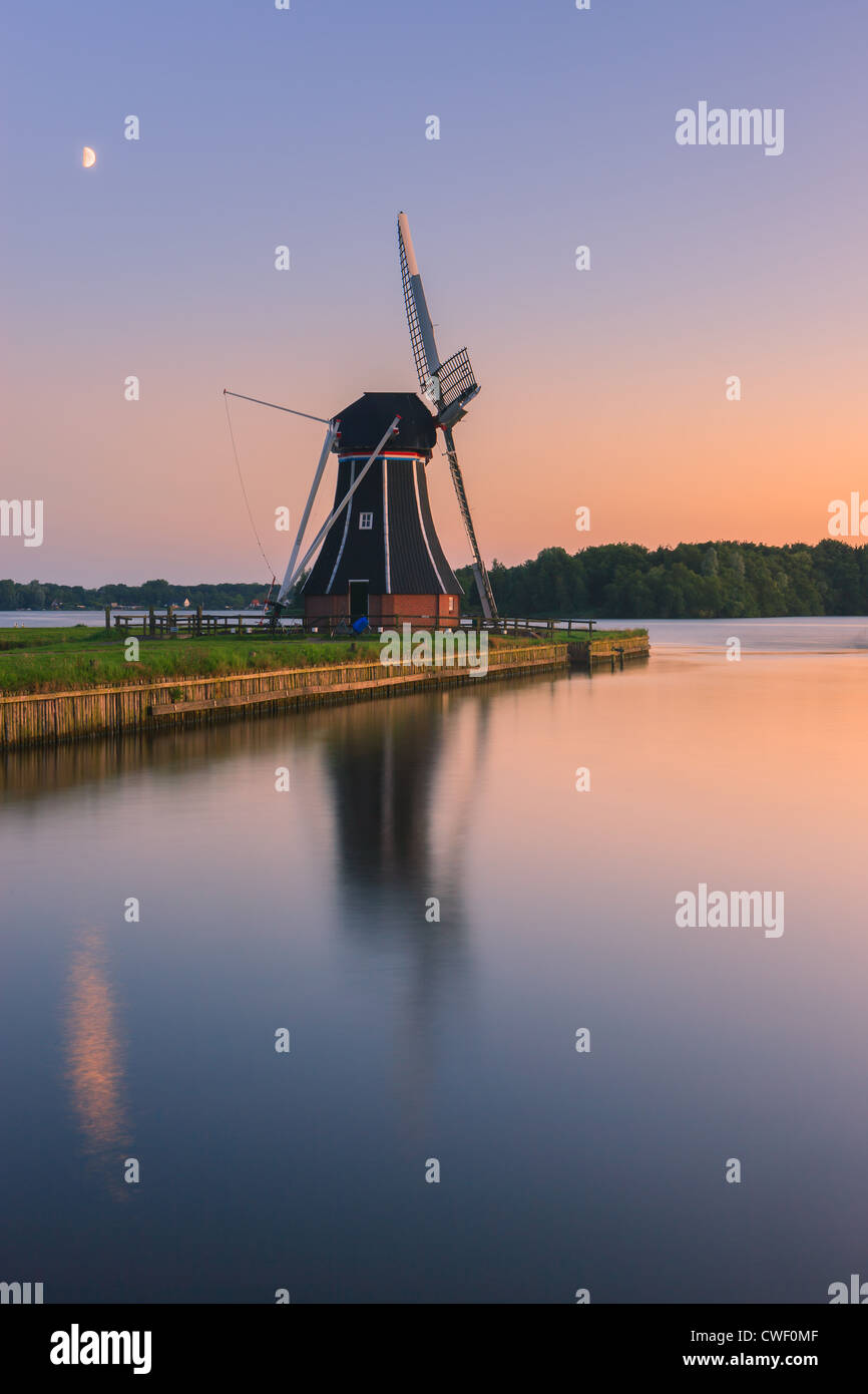 Windmill De Helper at Paterswoldsemeer just after sunset, near Haren in the Province of Groningen, Netherlands - Stock Image