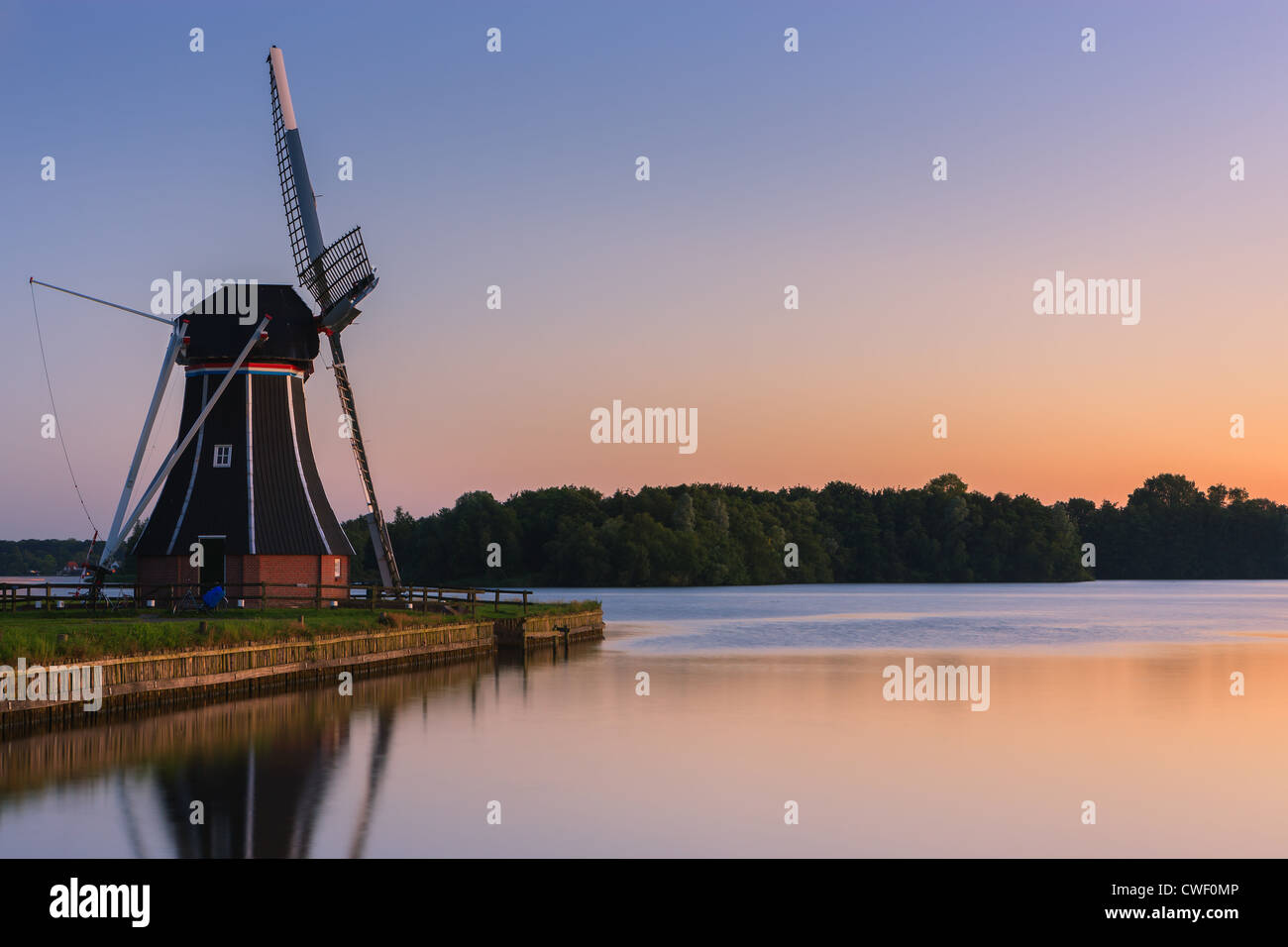 Windmill De Helper at Paterswoldsemeer just after sunset, near Haren in the Province of Groningen, Netherlands - Stock Image
