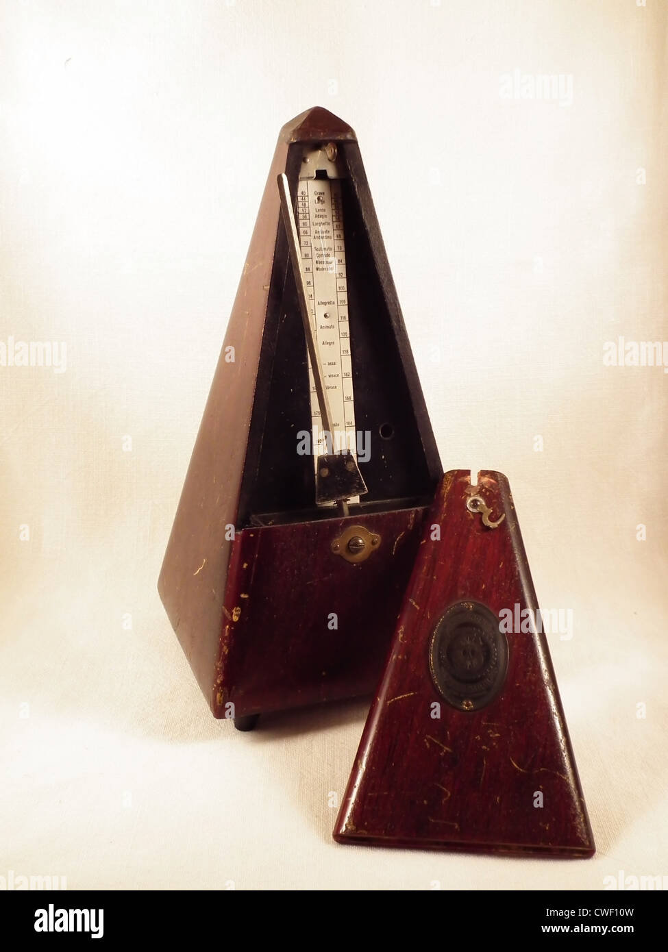 An old and wooden metronome from the collection of my parents - Stock Image