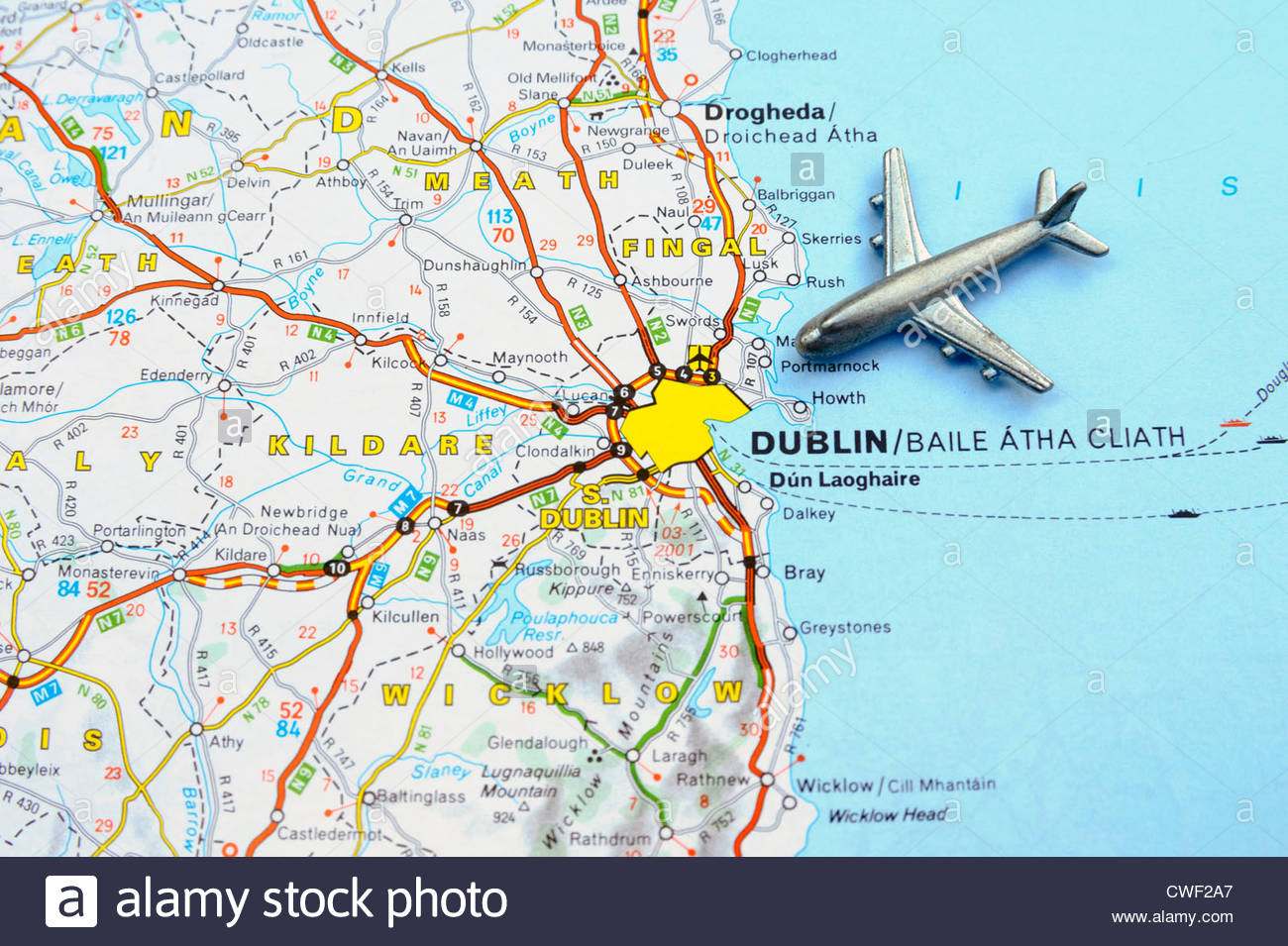 Destination Dublin. Toy aeroplane on a map showing Dublin, illustrating a journey or visit to Ireland. - Stock Image