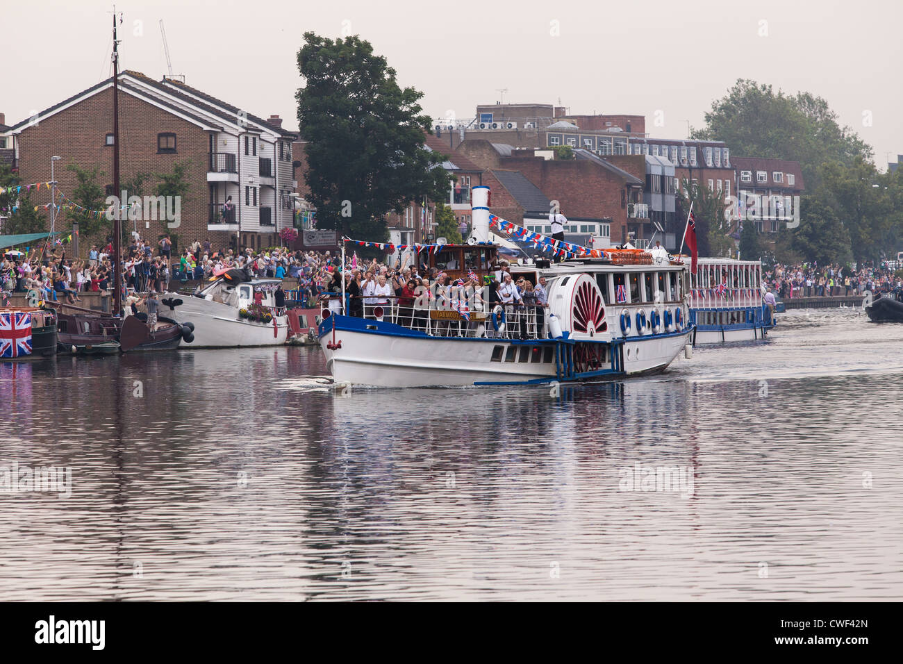 Yarmouth Belle follows the 2012 Olympic Flame on Royal Boat Gloriana. - Stock Image