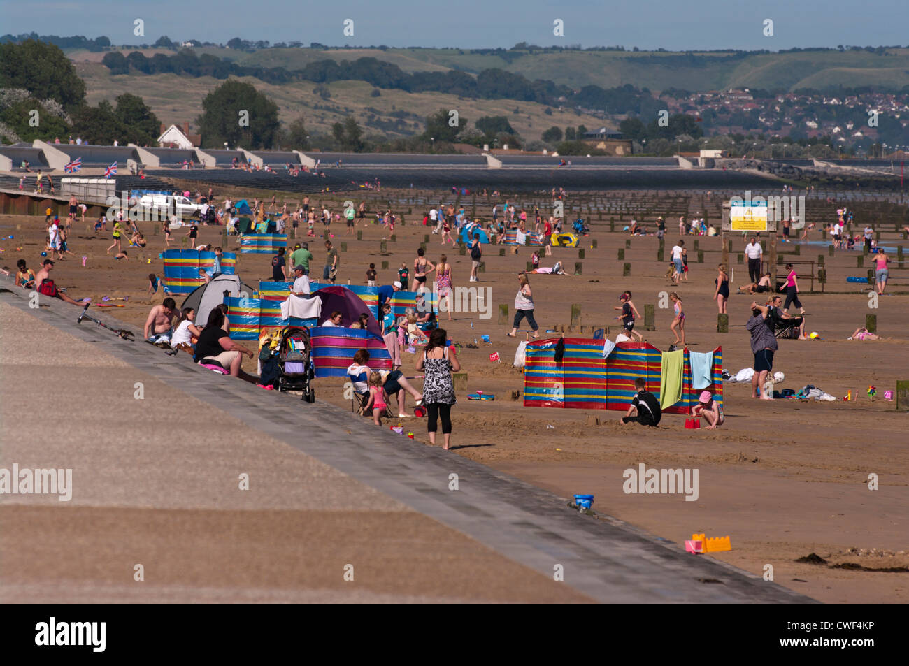 Holidaymakers On Dymchurch Beach Kent UK On A Summers Day Seaside Seasides - Stock Image