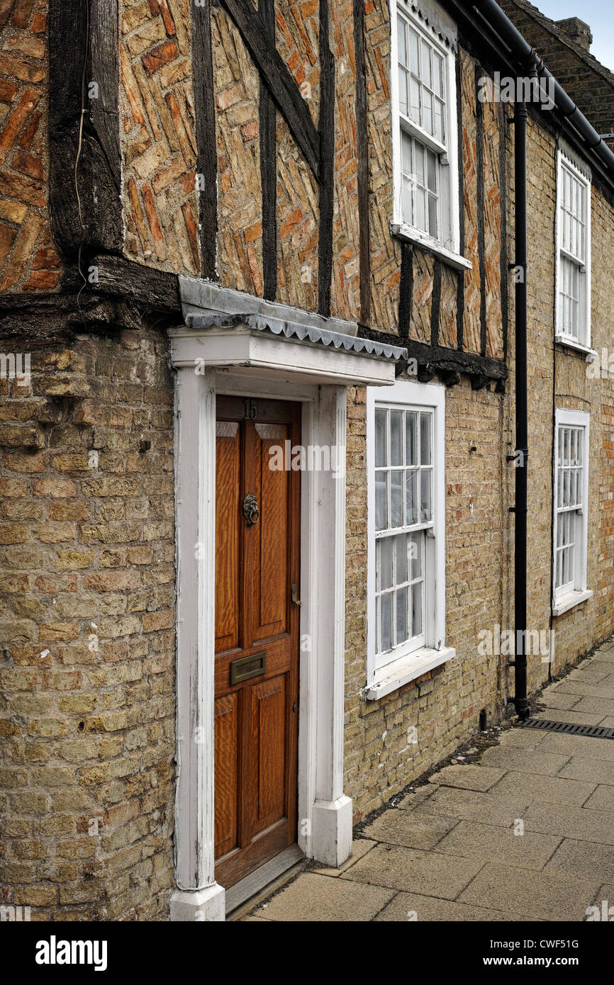 Old terraced house built of brick with timber frame in Waterside Ely Stock Photo