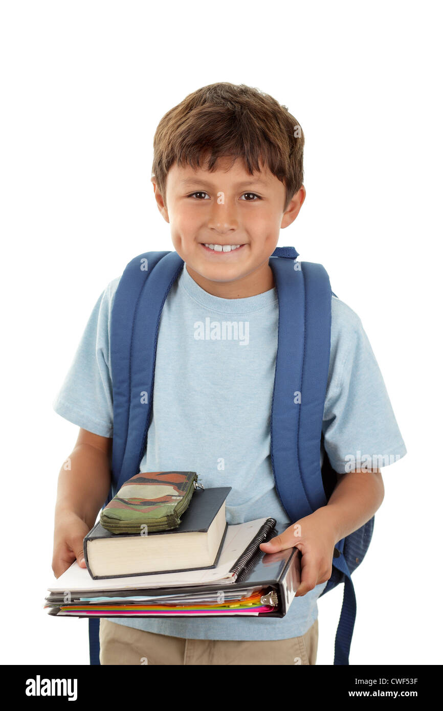 A young boy with a backpack returns to school after the holidays carrying his books - Stock Image