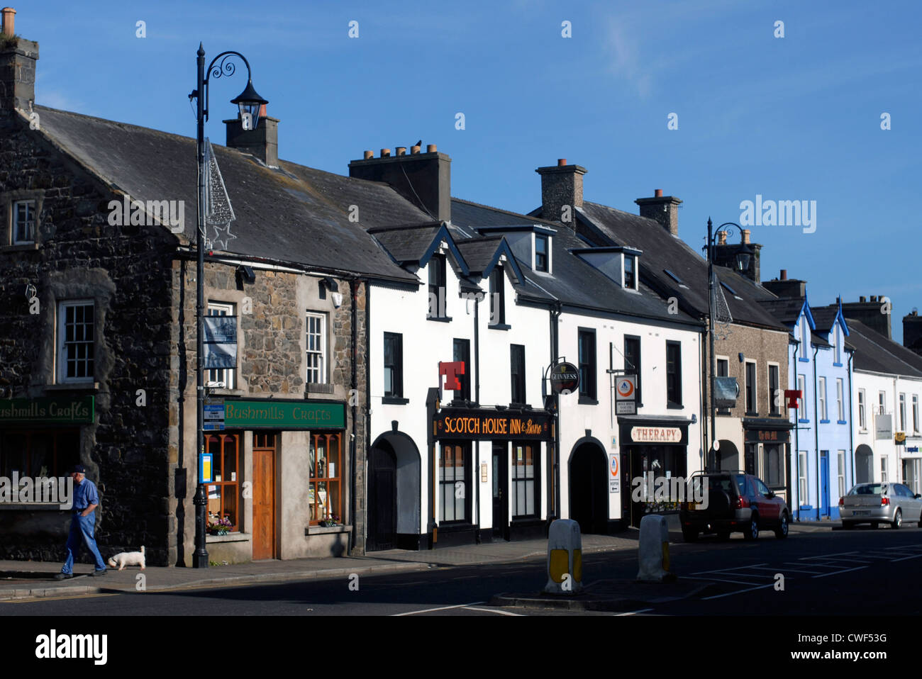 Main Street in Bushmills, Coastal Road, County Antrim, Ulster, North Ireland, UK, Europe. - Stock Image