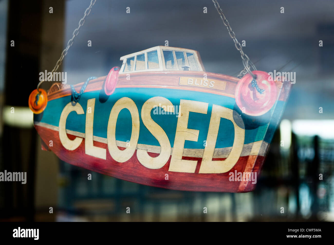 boat shaped closed sign in a shop window Stock Photo