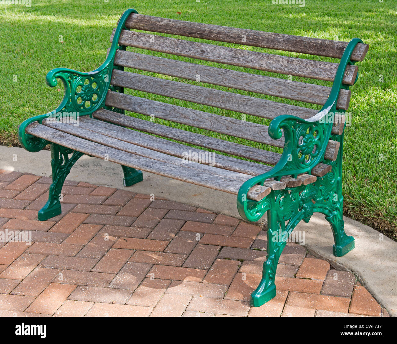 Park Bench Wood And Green Painted Metal Bench In A Public