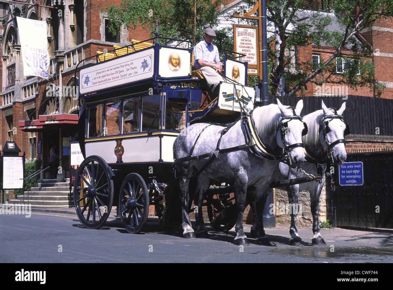 The Shakespearean horse-drawn omnibus tour, Stratford-upon-Avon, Warwickshire, UK - Stock Image