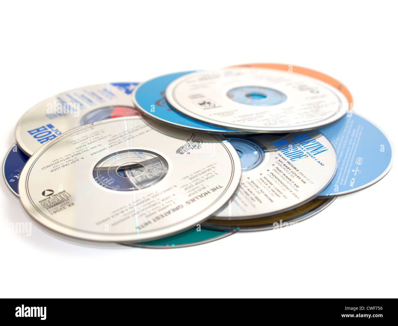 Music CDs  A pile of music compact discs on a white