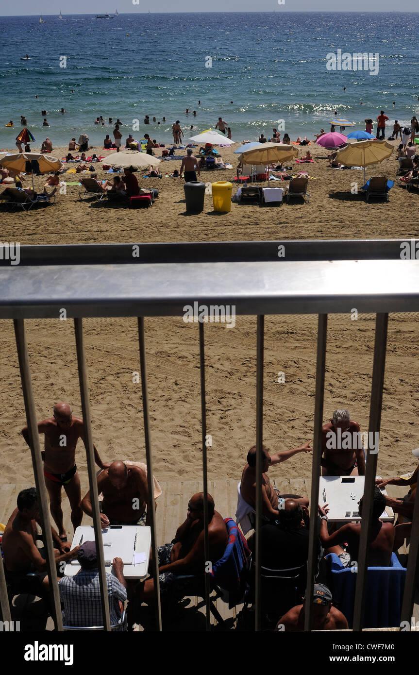 sunbathers on the barceloneta beach of Barcelona Spain - Stock Image