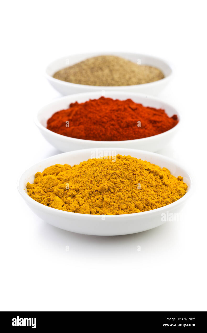 various colored spices in ceramic bowls - Stock Image