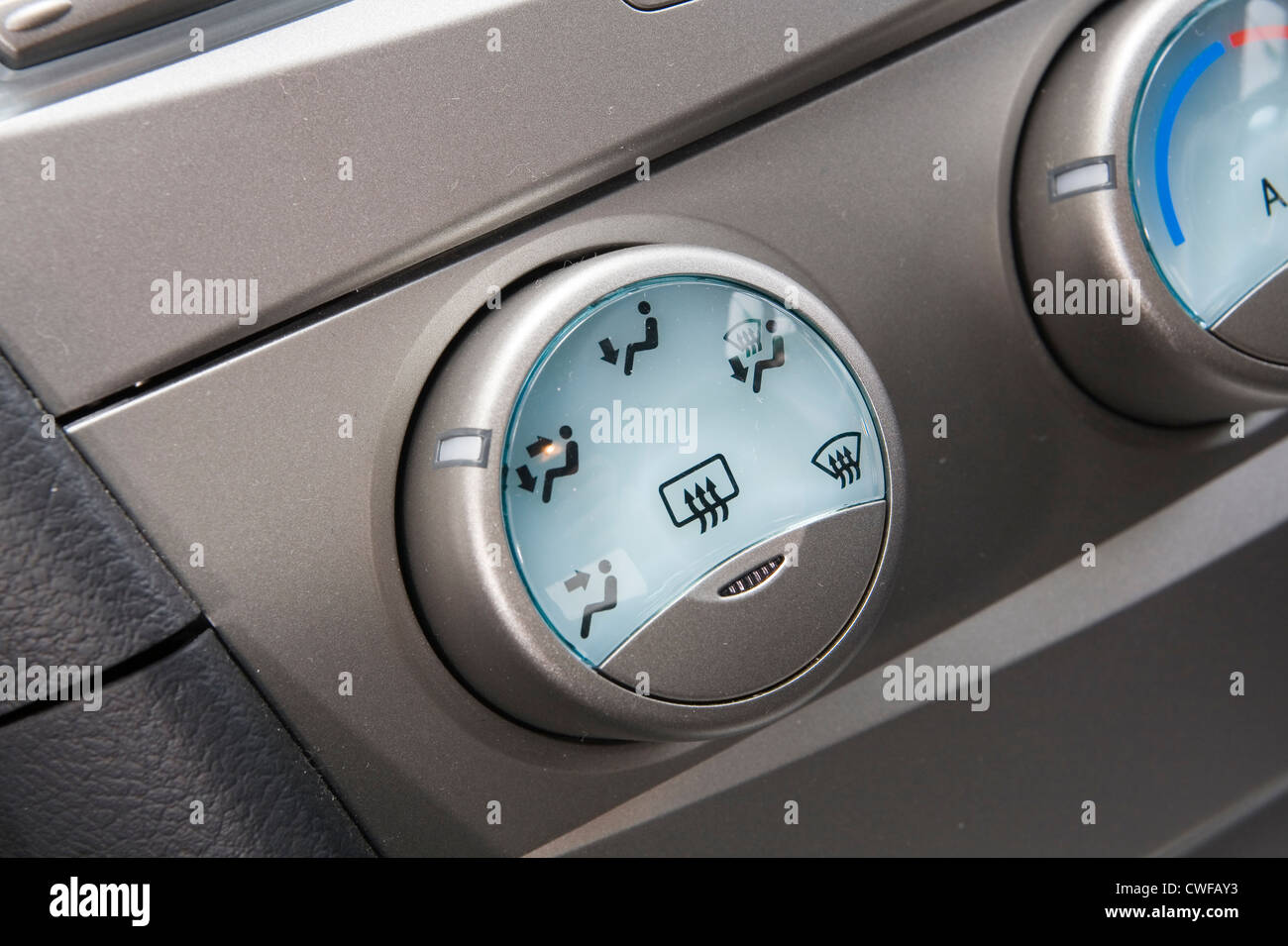 Air conditioning control dial in the cockpit cabin of a car. - Stock Image