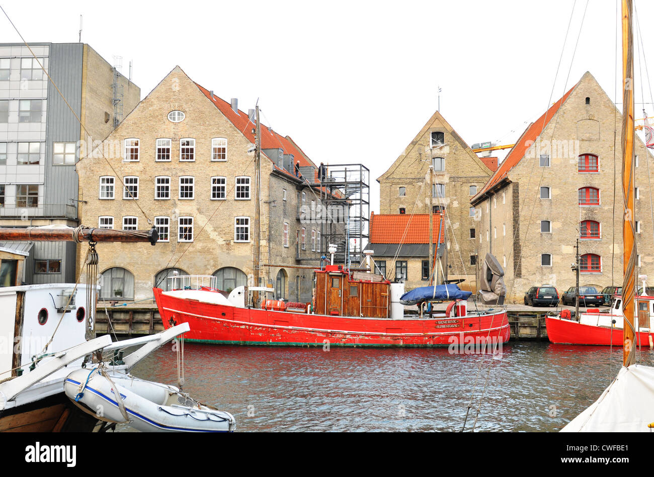 Copenhagen, Denmark - 19 Dec, 2011: Generic view of historical buildings and boats across the Nyhavn canal - Stock Image