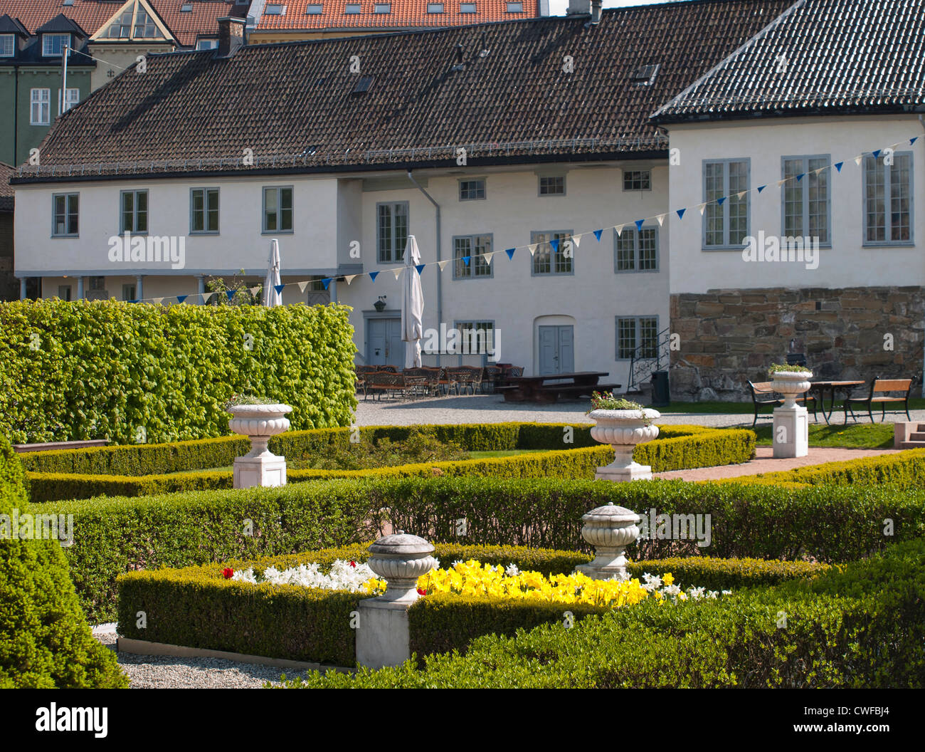 Old bishop`́s palace or Ladegården in Oslo Norway from 1725 with its newly restored baroque garden - Stock Image