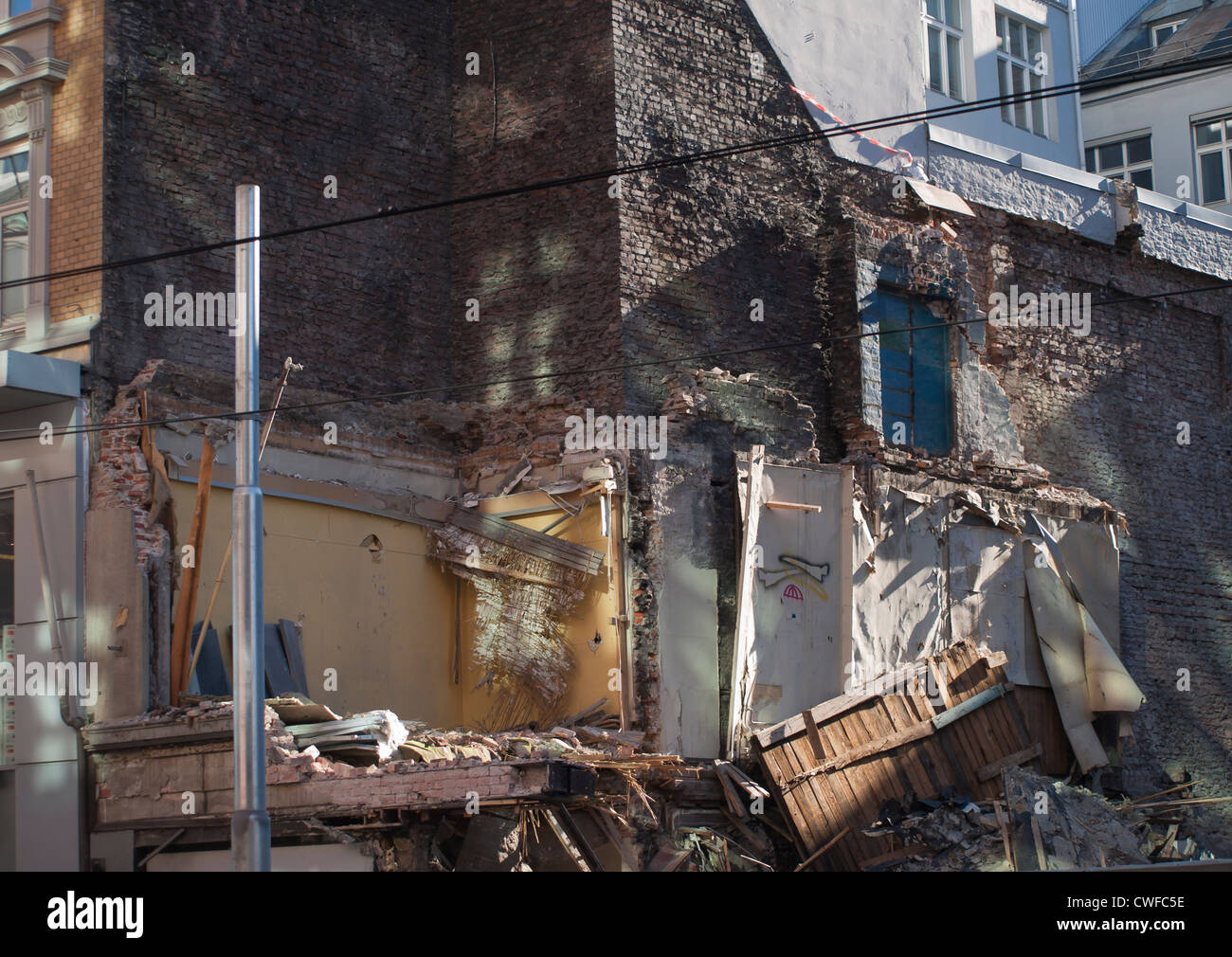 Demolition of an old shop in central Oslo shows signs of what was inside and room for renewal - Stock Image