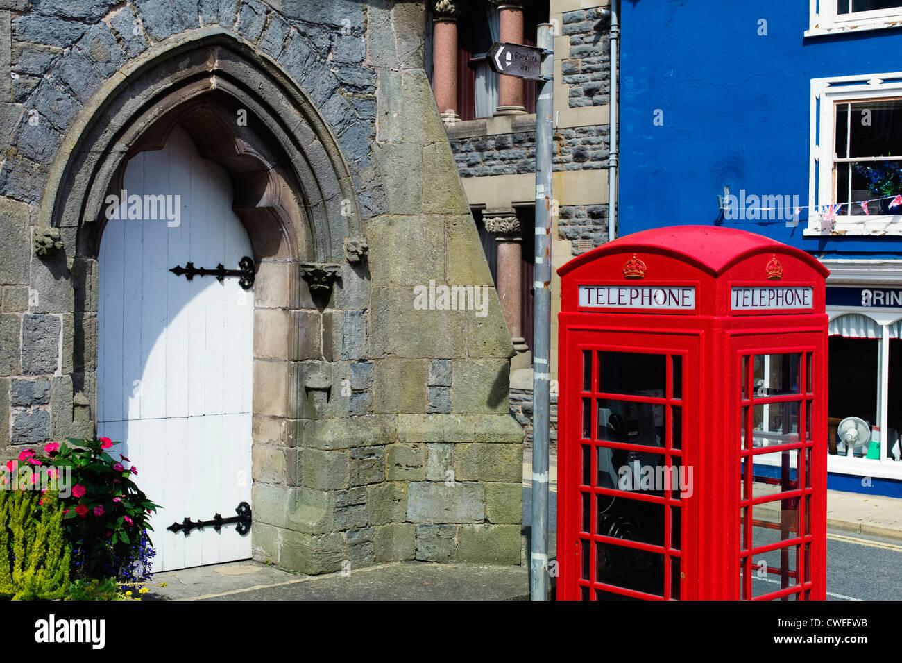 Clock tower and telephone kiosk Knighton Powys Wales - Stock Image