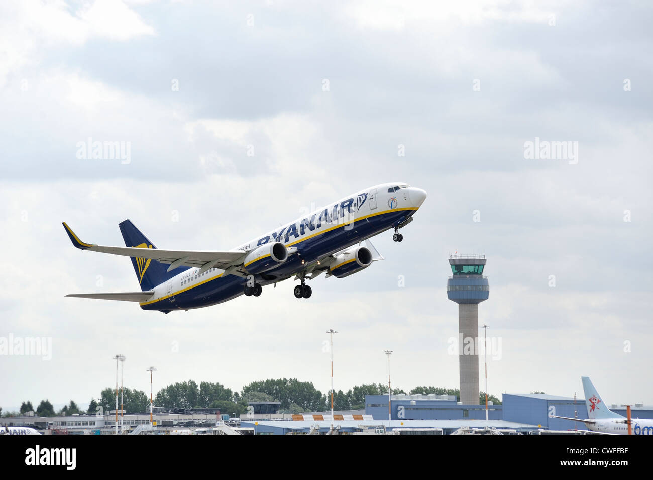 ryanair jet taking off with the air traffic control tower in the background. east midlands airport england uk Stock Photo