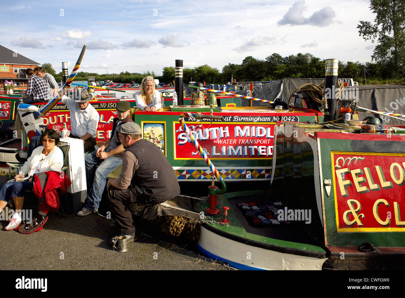Boaters in traditional costume with their colourful historic narrowboats, Alvecote Marina, Coventry Canal, near - Stock Image