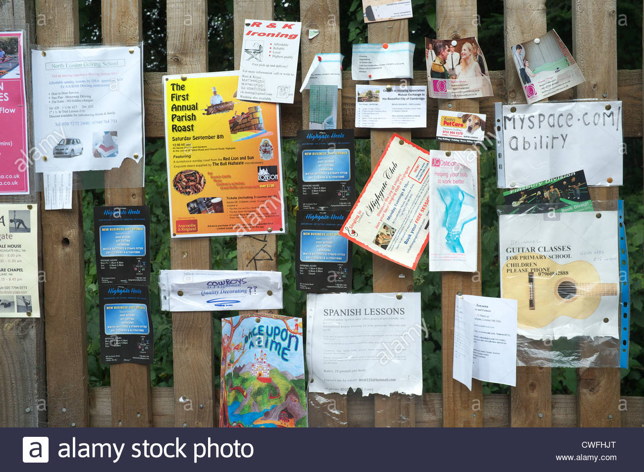 An unofficial notice board, on a fence in Muswell Hill Road, London, UK. - Stock Image