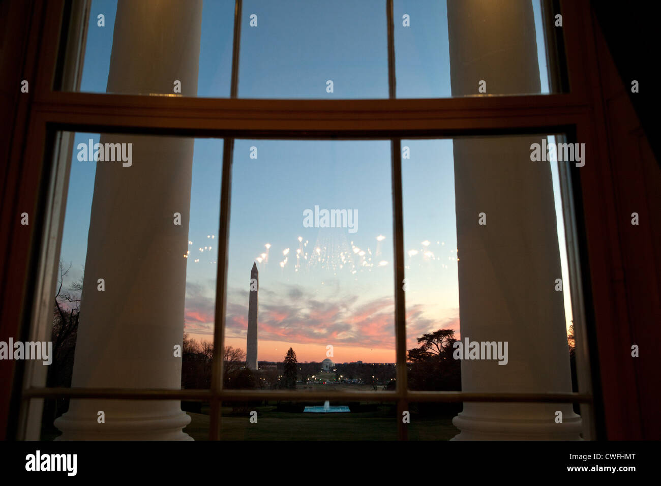 A view of the South Lawn is seen at sunset from the Blue Room of the White House, Jan. 18, 2012. (Official White - Stock Image