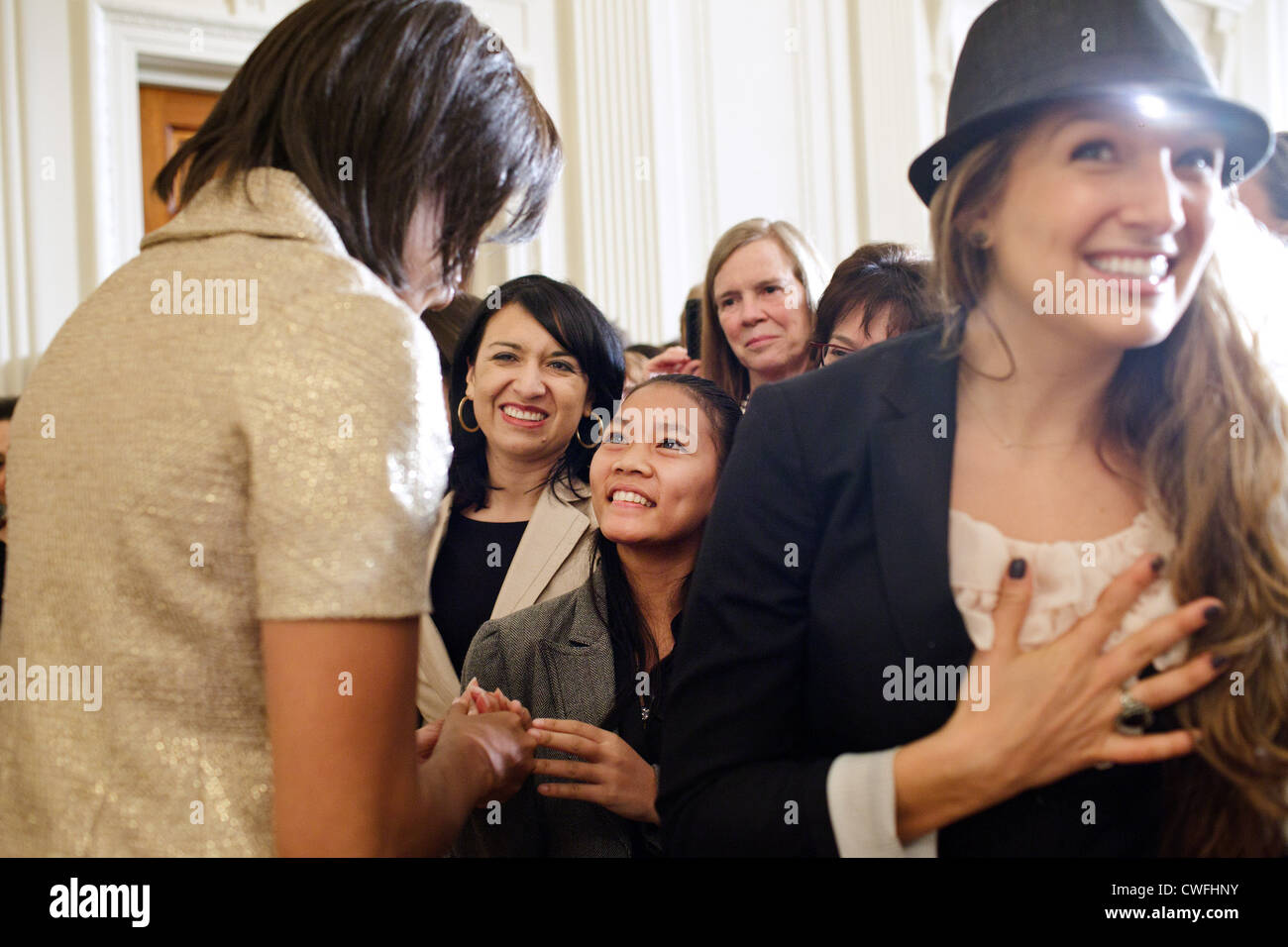 First Lady Michelle Obama greets guests during the International Women's Day reception in the East Room of the - Stock Image