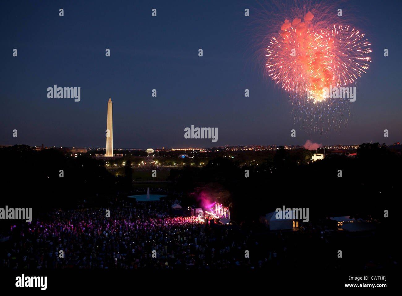Fireworks begin as the Killers perform on the South Lawn of the White House, July 4, 2010, during the Fourth of - Stock Image