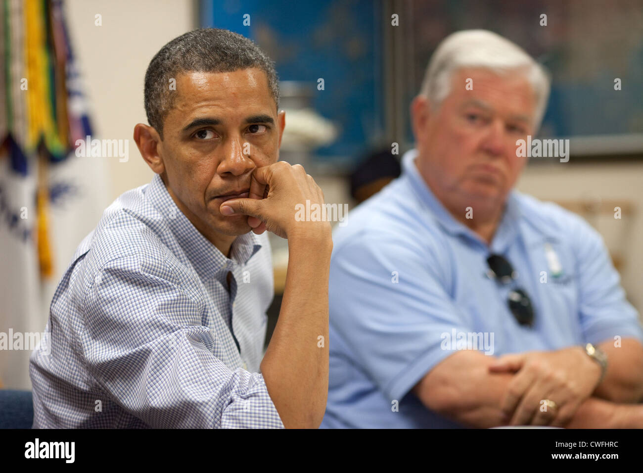 President Barack Obama listens during a briefing about the ongoing response to the BP oil spill, at the Gulfport - Stock Image